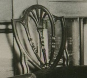 Photograph of a Hepplewhite-style chair in the dining room of the Morris-Jumel Mansion, 1887.